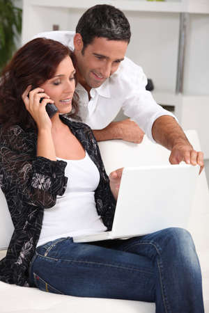 existence: Couple with computer and phone