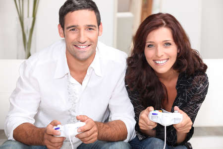 Couple playing computer games photo