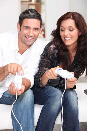Couple playing a video game together photo