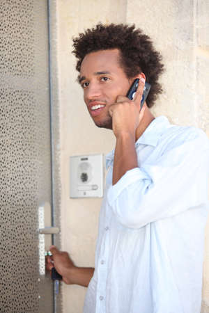 portrait of a young man at door Stock Photo - 13958556