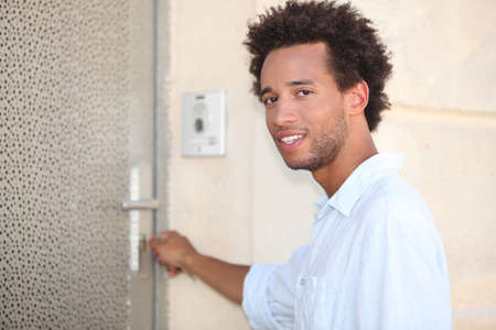 Man putting key in door Stock Photo - 13958254