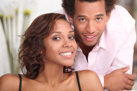 settee: Young couple relaxing at home Stock Photo