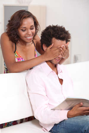 exchanging: Woman making surprise to her boyfriend