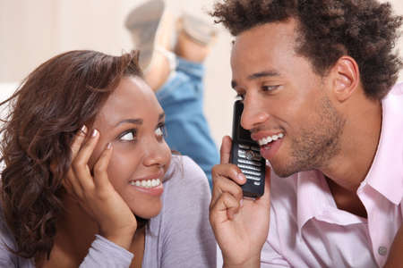 Couple on the phone Stock Photo - 14025926