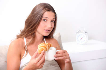 woman having breakfast in bed photo