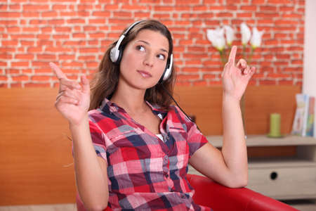 young woman listening music at home Stock Photo - 13959018