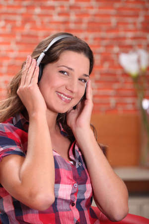 young woman listening music photo