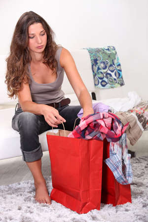 girl at home after shopping frenzy photo