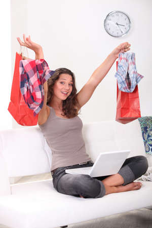 Brunette shopping online at home photo