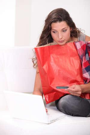 later: Brunette shopping online Stock Photo