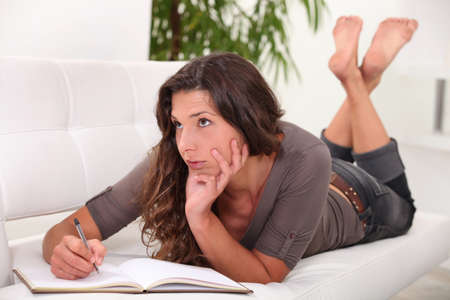 Woman writing in her diary photo