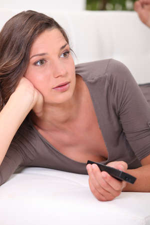 Woman with remote control Stock Photo - 13958035