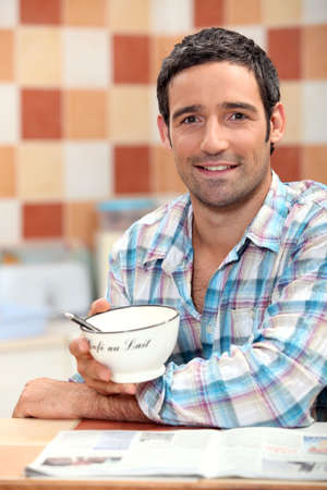 Man having his breakfast photo