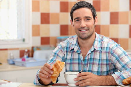 Man eating a continental breakfast photo