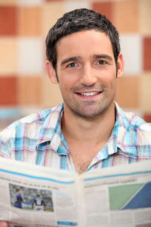 hairy chest: Smiling man reading a newspaper