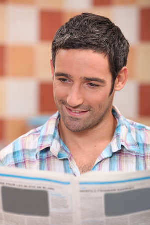 35 years old man reading newspaper photo
