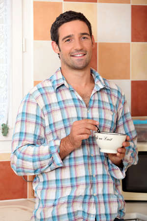 Man eating cereal Stock Photo