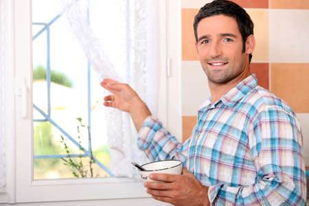 pileup: Man with bowl looking out the window