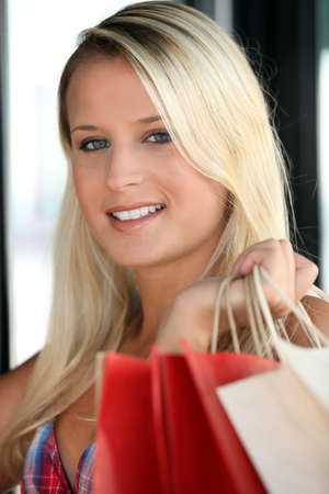 Young woman with store bags photo