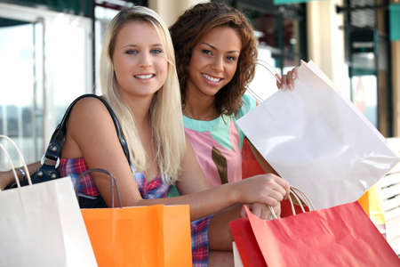 Two beautiful girls shopping photo