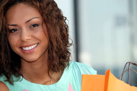 beautiful young woman holding a shopping bag photo