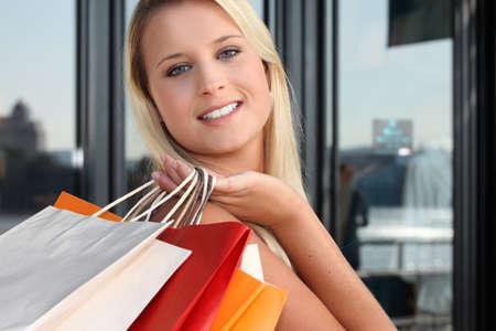 a blonde woman doing shopping photo