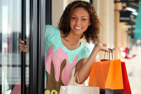 Pretty young woman shopping photo
