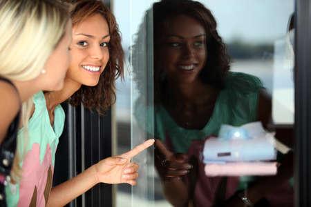 Two female friends window shopping photo