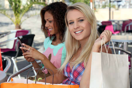 parentheses: Two women shopping
