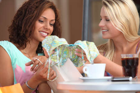 Women hanging out together after shopping photo