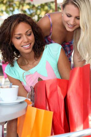 Women taking a break from shopping photo