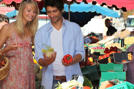 Couple choosing vegetables at the market photo