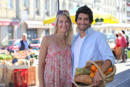 blissfully: couple smiling blissfully at market