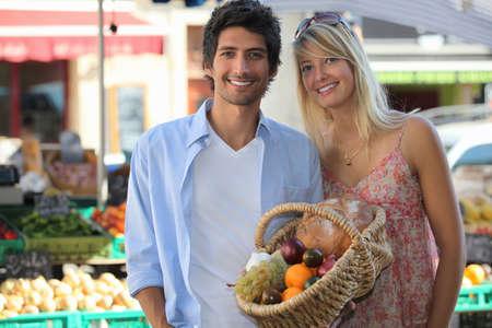 Couple shopping at market Stock Photo - 14019804
