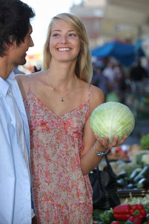 Couple buying vegetables photo