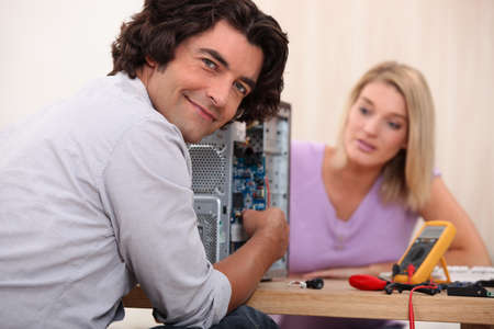 Couple repairing computer photo