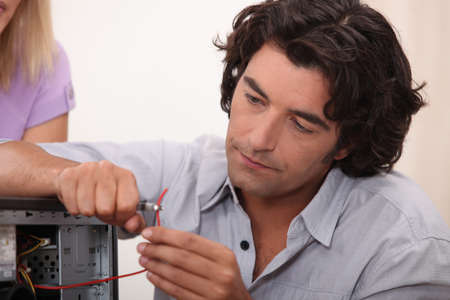 Man fixing a hard drive photo