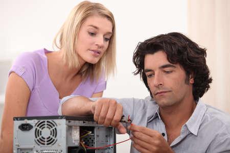 Man cutting a wire photo