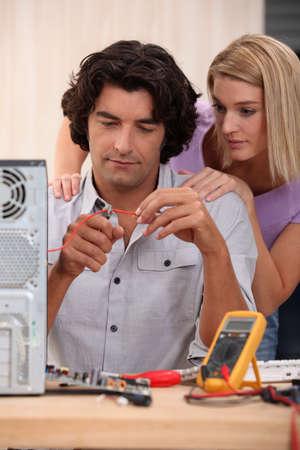 Technician repairing computer photo