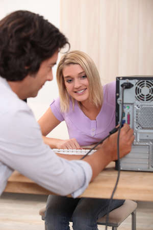 Computer technician helping woman photo
