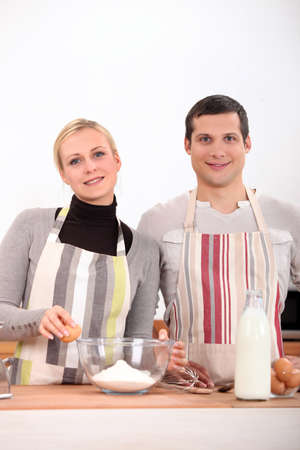 Couple baking in the kitchen Stock Photo - 14014353