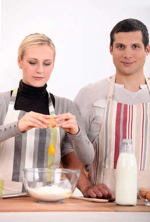 Couple baking together photo