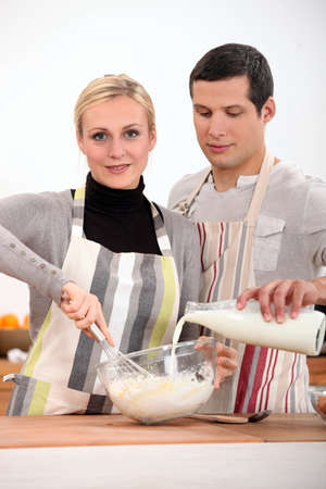 Couple in the kitchen baking photo