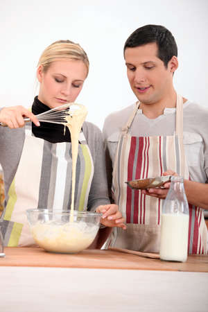 couple cooking together photo