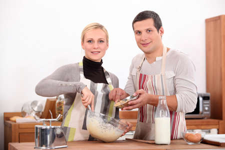 Couple baking in kitchen photo