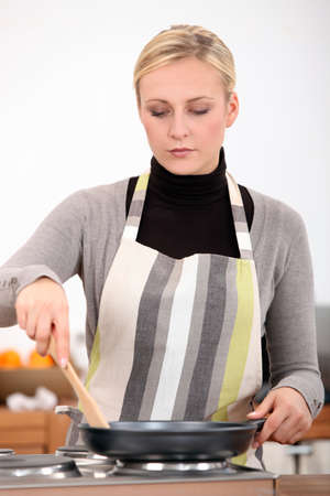 pileup: Woman with pan in the kitchen