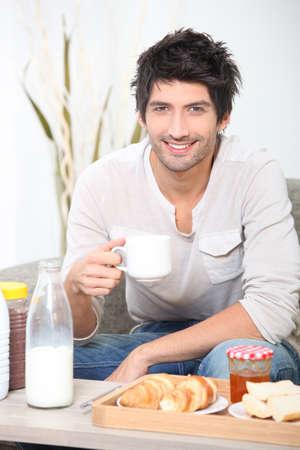 caf: Man having breakfast Stock Photo