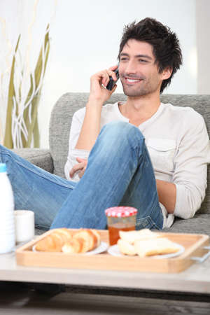 Man talking on his mobile phone before breakfast photo