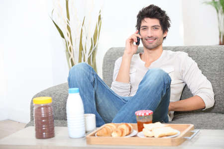 laze: Man eating breakfast at home