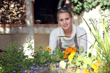 petunias: Young female gardener